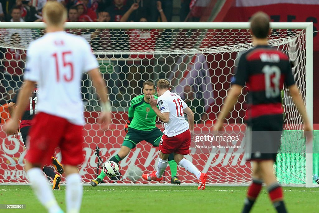 Sebastian Mila of Poland scores the 2nd team goal against Manuel Neuer, keeper of Germany during of the EURO 2016 Group D qualifying match between Poland and Germany at Narodowy Stadium on October 11, 2014 in Warsaw, Poland.