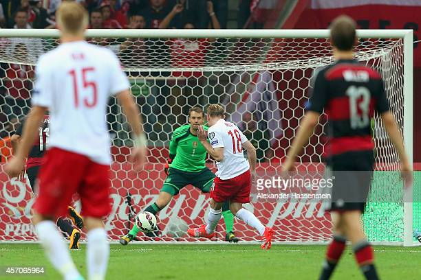 Sebastian Mila of Poland scores the 2nd team goal against Manuel Neuer keeper of Germany during of the EURO 2016 Group D qualifying match between...