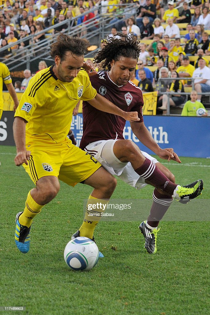 Sebastian Miranda #21 of the Columbus Crew and Quincy Amarikwa #12 of the Colorado Rapids battle for control of the ball on June 26, 2011 at Crew Stadium in Columbus, Ohio. Columbus defeated Colorado 4-1.
