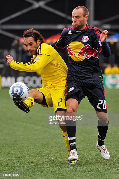 Sebastian Miranda of the Columbus Crew gets control of the ball in front of Joel Lindpere of the New York Red Bulls on March 26 2011 at Crew Stadium...