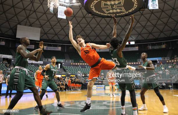 Sebastian Much of the Princeton Tigers takes an off balance shot during the first half of the 5th place game against the Hawaii Rainbow Warriors of...