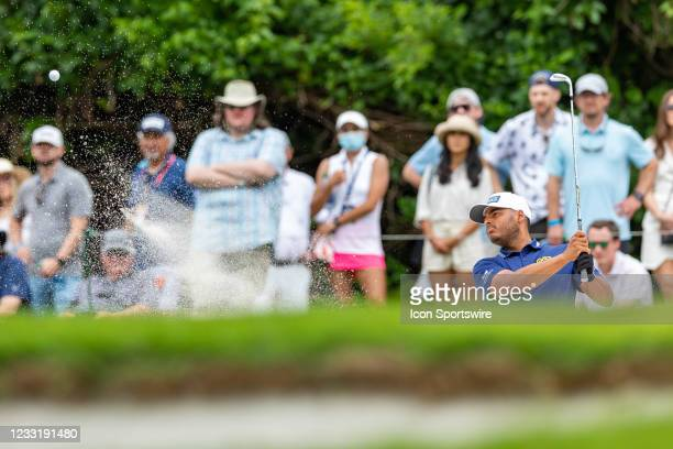 Sebastian Munoz hits from the green side bunker on during the final round of the Charles Schwab Challenge on May 30, 2021 at Colonial Country Club in...
