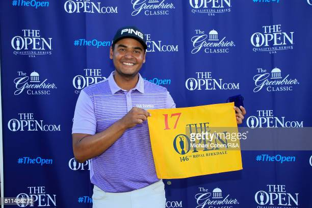 Sebastian Munoz of Colombia holds a hole flag after qualifying for the Open Championship during the fourth and final round of The Greenbrier Classic...