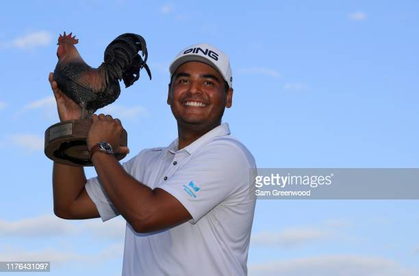 Sebastian Munoz of Colombia poses with the trophy after putting in to win in a sudden death playoff during the final round of the Sanderson Farms...