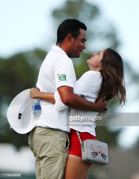 Sebastian Munoz of Colombia reacts with his girlfriend Daniela Granados after putting in win in a sudden death playoff on the 18th hole during the...