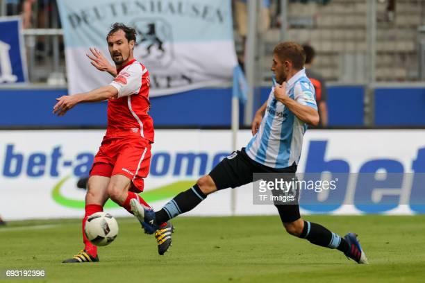 Sebastian Nachreiner of Jahn Regensburg and Levent Aycicek of 1860 Munich battle for the ball during the Second Bundesliga Playoff second leg match...