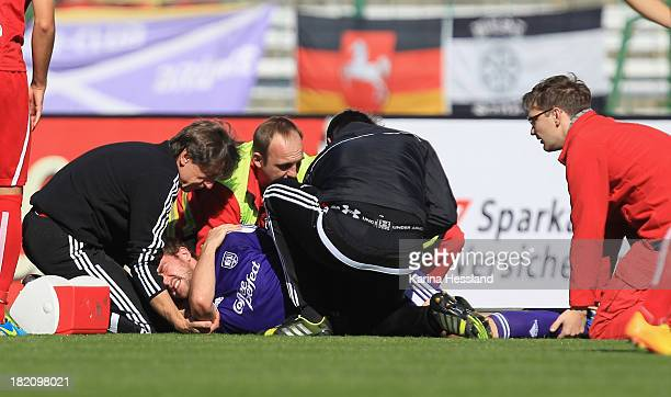 Sebastian Neumann of Osnabrueck is treated on the pitch after suffering an injury during the Third League match between RW Erfurt and VfL Osnabrueck...