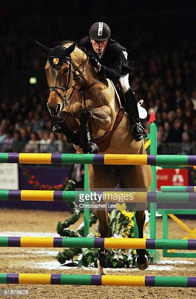 Sebastian Numminen of Finland rides Miss Speed during the FEI World Cup Qualifier during the Olympia London International Horse Show at Olympia on...
