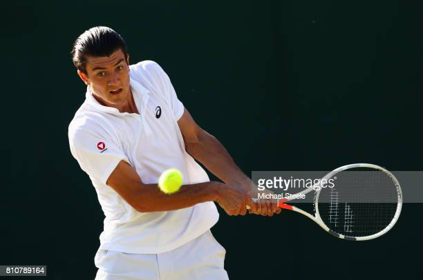 Sebastian Ofner of Austria plays a backhand during the Gentlemen's Singles third round match against Alexander Zverev of Germany on day six of the...