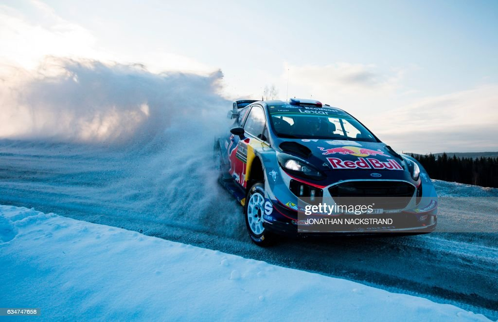 TOPSHOT - Sebastian Ogier of France and his co-driver Julien Ingrassia compete in their Ford Fiesta WRC during the 13th stage of the Rally Sweden, second round of the FIA World Rally Championship on February 11, 2017 in Hagfors, Sweden. / AFP PHOTO / Jonathan NACKSTRAND