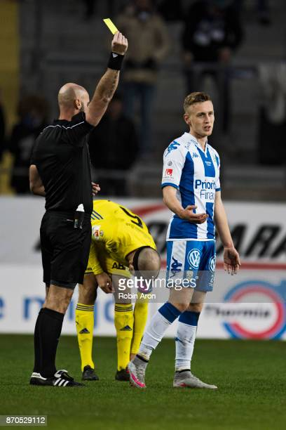 Sebastian Olsson of IFK Goteborg receives a yellow card from referee Stefan Johannesson during the Allsvenskan match between IFK Goteborg and GIF...
