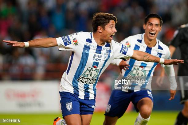 Sebastian Palacios celebrates after scoring the equalizer with teammate Erick Aguirre of Pachuca during the 13th round match between Pachuca and...