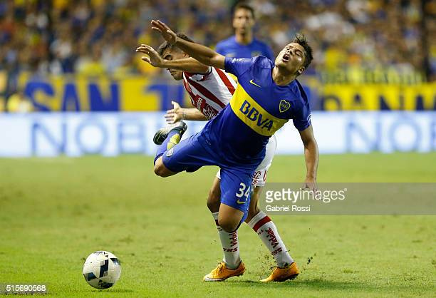 Sebastian Palacios of Boca Juniors falls as he fights for the ball with Victor Malcorra of Union during a match between Boca Juniors and Union as...