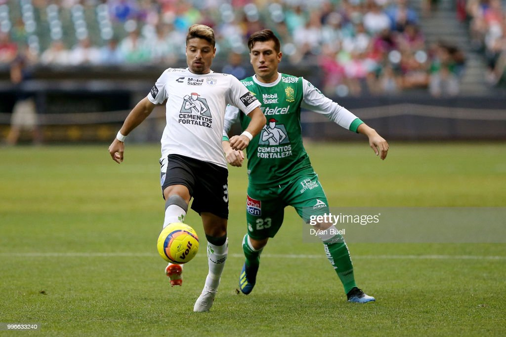 Sebastian Palacios #34 of CF Pachuca dribbles the ball while being pressured by Juan Cornejo #23 of Club Leon in the first half at Miller Park on July 11, 2018 in Milwaukee, Wisconsin.