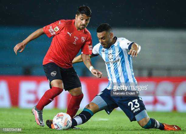Sebastian Palacios of Independiente fights for the ball with Nery Dominguez of Racing Club during a match between Racing Club and Independiente as...