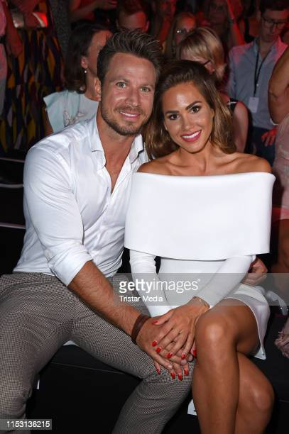 Sebastian Pannek and his new girlfriend Angelina Heger attend the Guido Maria Kretschmer fashion show during the Berlin Fashion Week Spring/Summer...