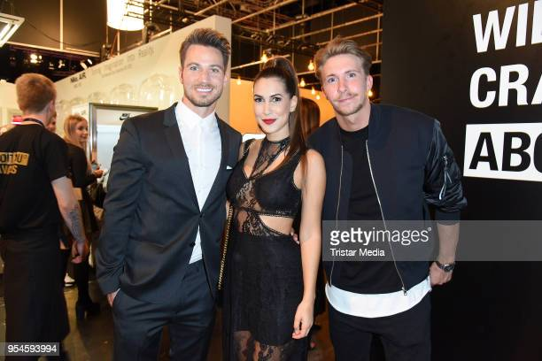 Sebastian Pannek his girlfriend CleaLacy Juhn and David Friedrich during the ABOUT YOU Awards at Bavaria Studios on May 3 2018 in Munich Germany