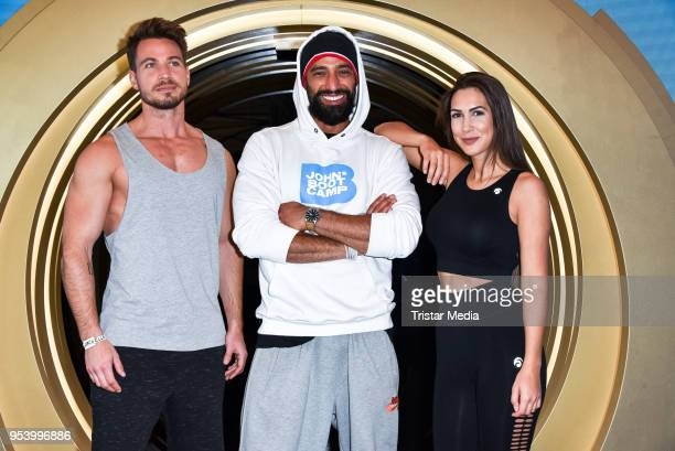 Sebastian Pannek with his girlfriend CleaLacy Juhn and Tamer Trasoglu during John's Bootcamp Opening on May 2 2018 in Berlin Germany