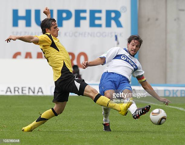 Sebastian Pelzer of Rostock and Massimo Cannizzaro of Koblenz battle for the ball during the Third League match between Hansa Rostock and TuS Koblenz...