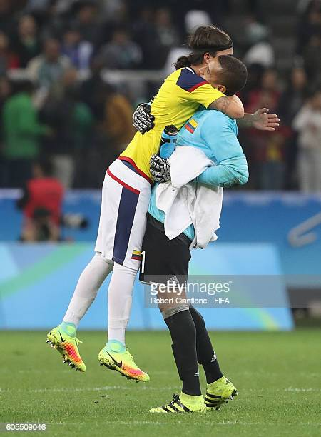 Sebastian Perez and Colombian goalkeeper Cristian Bonilla celebrate after Colombia defeated Nigeria during the Men's First Round Group B match...