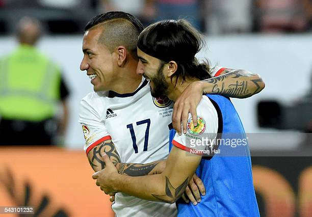 Sebastian Perez and Dayro Moreno of Colombia celebrate a win against the United States during a third place match between United States and Colombia...