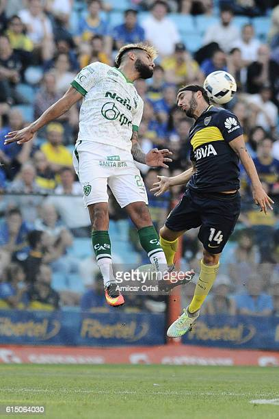 Sebastian Perez of Boca Juniors and Adrian Balboa of Sarmiento jump for a header during a match between Boca Juniors and Sarmiento as part of Torneo...