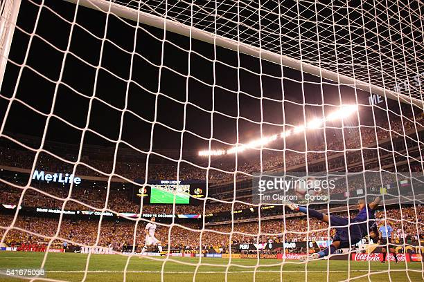 Sebastian Perez of Colombia scores from the penalty spot beating goalkeeper Pedro Gallese of Peru in the penalty shoot out won by Colombia during the...