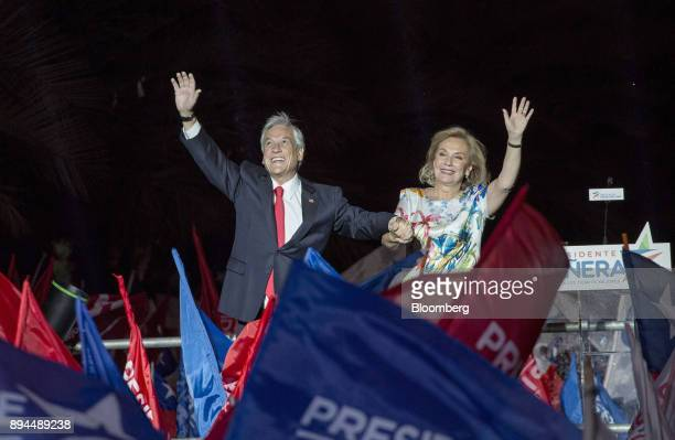 Sebastian Pinera Chile's presidentelect and wife Cecilia Morel greet his supporters at the National Renewal party headquarters after the second round...