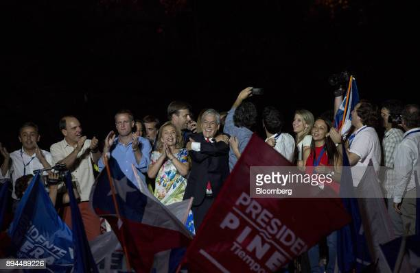 Sebastian Pinera Chile's presidentelect center and wife Cecilia Morel left greet his supporters at the National Renewal party headquarters after the...