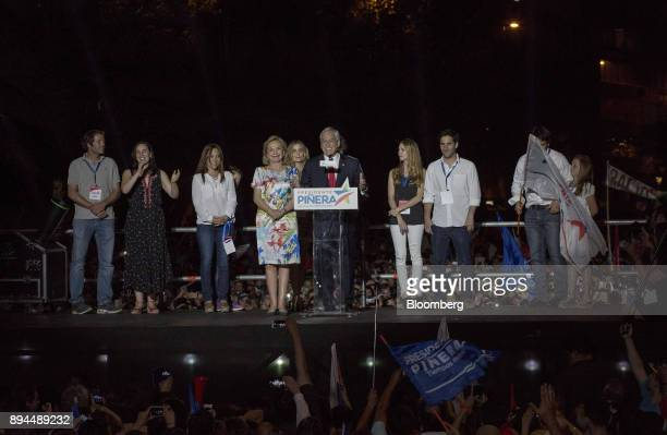 Sebastian Pinera Chile's presidentelect center stands with his wife Cecilia Morel left as he speaks to his supporters at the National Renewal party...