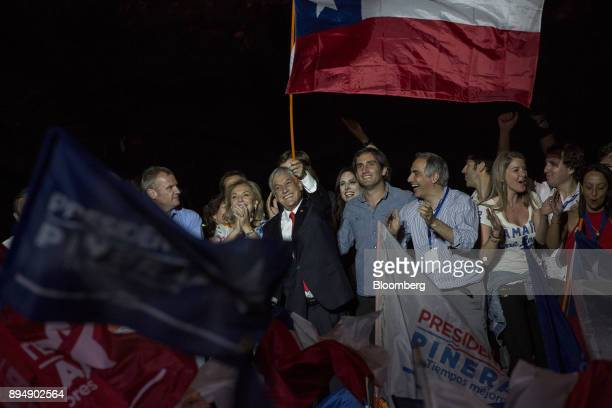 Sebastian Pinera Chile's presidentelect center waves a Chilean flag at the National Renewal party headquarters after the second round presidential...