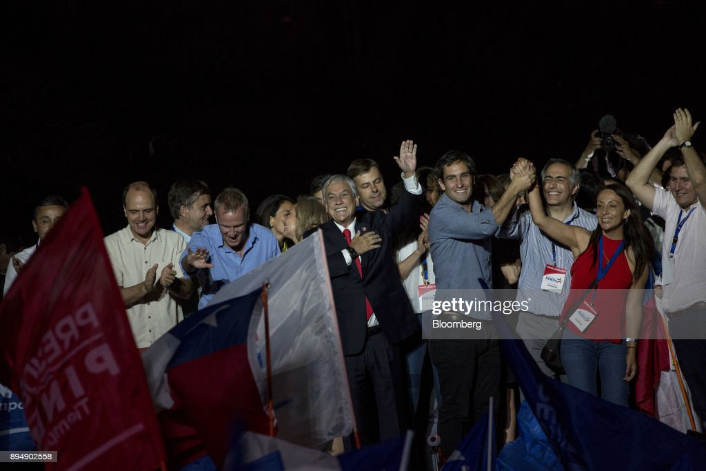 Sebastian Pinera, Chile's president-elect, center, waves to supporters at the National Renewal party headquarters after the second round presidential general elections in Santiago, Chile, on Sunday, Dec. 17, 2017. Pinera swept to victory in the run-off of Chile's presidential election, winning by a wider than expected margin, after pledging to reverse four years of sluggish economic growth. Photographer: Cristobal Olivares/Bloomberg via Getty Images