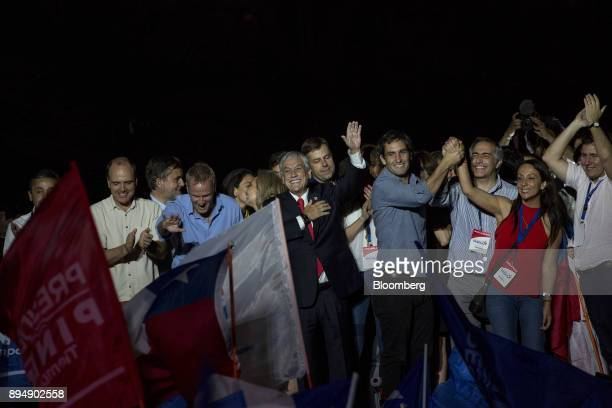 Sebastian Pinera Chile's presidentelect center waves to supporters at the National Renewal party headquarters after the second round presidential...