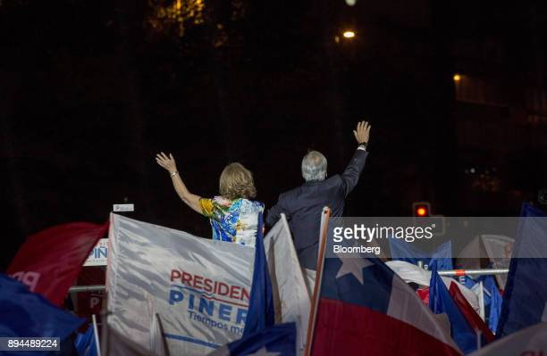 Sebastian Pinera Chile's presidentelect right and wife Cecilia Morel greet supporters at the National Renewal party headquarters after the second...