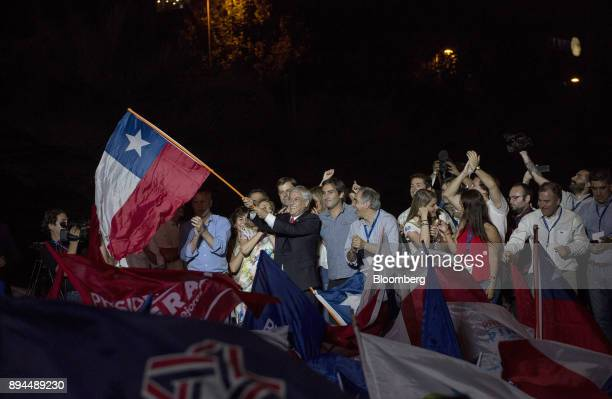 Sebastian Pinera Chile's presidentelect waves a Chilean national flag at the National Renewal party headquarters after the second round presidential...
