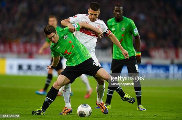 Sebastian Pocognoli of Hannover is challenged by Vedad Ibisevic of Stuttgart during the Bundesliga match between VfB Stuttgart and Hannover 96 at...