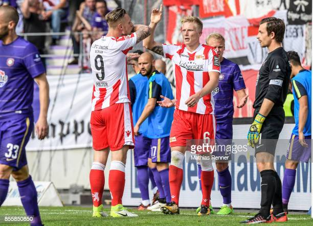 Sebastian Polter and Kristian Pedersen of 1.FC Union Berlin celebrate after scoring the 0:2 during the game between FC Erzgebirge Aue and FC Union...