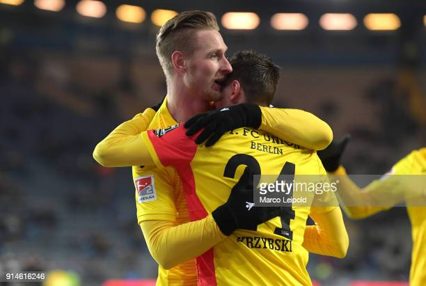 Sebastian Polter and Steven Skrzybski of 1 FC Union Berlin celebrate after scoring the opening goal during the Second Bundesliga match between DSC...