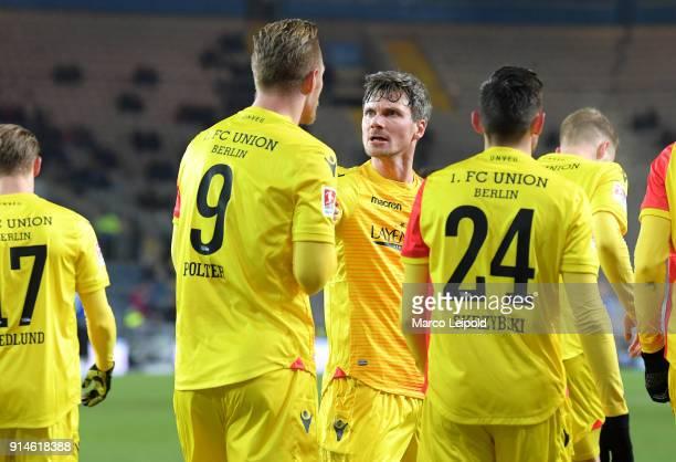 Sebastian Polter Michael Parensen and Steven Skrzybski of 1 FC Union Berlin celebrate the 01 during the Second Bundesliga match between DSC Arminia...