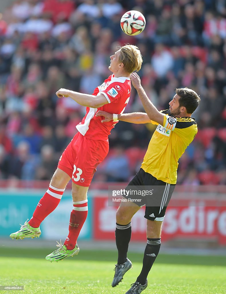 Sebastian Polter of 1 FC Union Berlin and Leandro Grech of VfR Aalen during the game between Union Berlin and VfR Aalen on april 12, 2015 in Berlin, Germany.