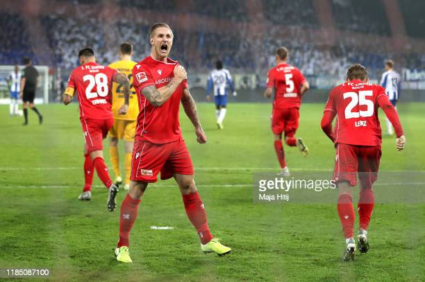 Sebastian Polter of 1 FC Union Berlin celebrates after scoring his team's first goal during the Bundesliga match between 1 FC Union Berlin and Hertha...