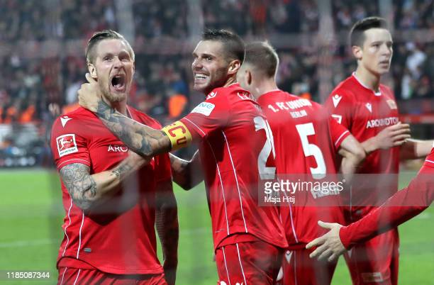 Sebastian Polter of 1 FC Union Berlin celebrates with teammate Christopher Trimmel after scoring his team's first goal during the Bundesliga match...