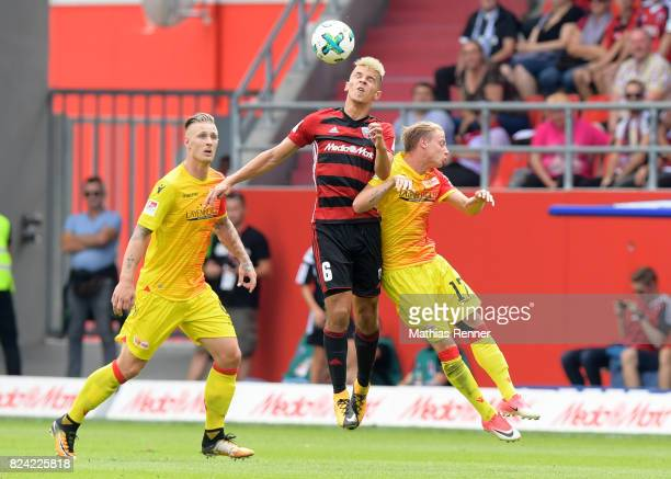 Sebastian Polter of 1FC Union Berlin Alfredo Morales of FC Ingolstadt 04 and Simon Hedlund of 1 FC Union Berlin during the game between FC Ingolstadt...