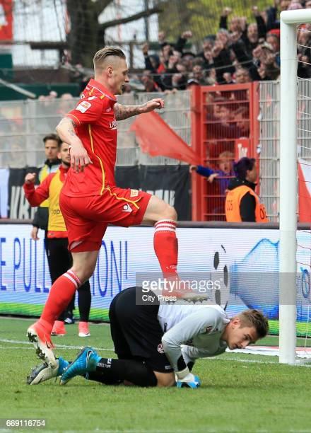 Sebastian Polter of 1FC Union Berlin and Julian Pollersbeck of 1 FC Kaiserslautern during the game between 1 FC Union Berlin and 1 FC Kaiserslautern...