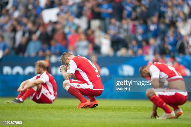 Sebastian Polter of 1.FC Union Berlin and players react after the Second Bundesliga match between VfL Bochum 1848 and 1. FC Union Berlin at Vonovia...