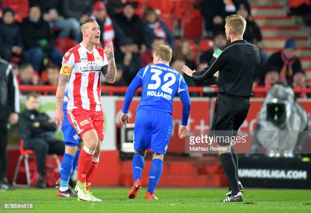 Sebastian Polter of 1FC Union Berlin and referee Timo Gerach during the Second Bundesliga match between Union Berlin and SC Darmstadt 98 on November...