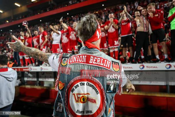 Sebastian Polter of 1FC Union Berlin and the team of 1 FC Union Berlin celebrate after their promotion to the Bundesliga after the playoff second leg...
