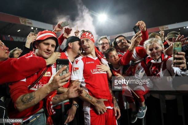 Sebastian Polter of 1FC Union Berlin celebrate with the fans after the Bundesliga playoff second leg match between 1 FC Union Berlin and VfB...