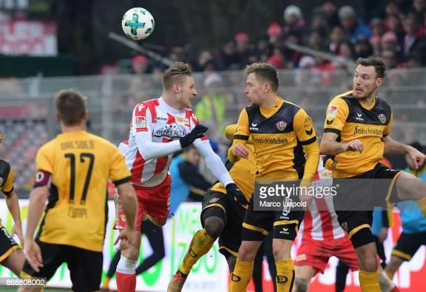 Sebastian Polter of 1FC Union Berlin Jannik Mueller and Jannik Mueller of SG Dynamo Dresden during the Second Bundesliga match between Union Berlin...