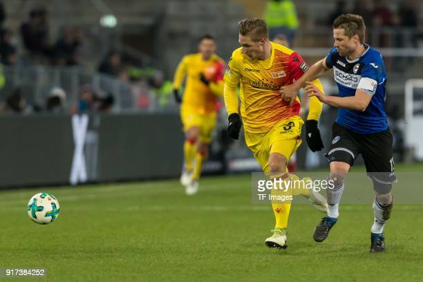 Sebastian Polter of Berlin and Julian Boerner of Bielefeld battle for the ball during the Second Bundesliga match between Arminia Bielefeld and Union...